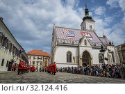 Купить «The Changing of the Guard, Croatian soldiers in historical regalia in ceremonial parade at St Mark's Square, Zagreb, Croatia.», фото № 32124416, снято 3 августа 2019 г. (c) age Fotostock / Фотобанк Лори