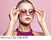 Купить «Close-up portrait of attractive young woman in tinted glasses and closed eyes», фото № 32126476, снято 1 июля 2019 г. (c) Serg Zastavkin / Фотобанк Лори