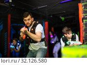 Купить «Excited guy during lasertag game», фото № 32126580, снято 25 апреля 2018 г. (c) Яков Филимонов / Фотобанк Лори