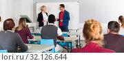 Купить «Students working with professor in auditorium», фото № 32126644, снято 8 мая 2018 г. (c) Яков Филимонов / Фотобанк Лори