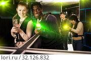 Купить «Multiracial couple playing lasertag», фото № 32126832, снято 23 января 2019 г. (c) Яков Филимонов / Фотобанк Лори