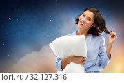 Купить «happy woman in pajama with pillow over night sky», фото № 32127316, снято 6 марта 2019 г. (c) Syda Productions / Фотобанк Лори