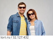 Купить «happy couple in sunglasses over grey background», фото № 32127432, снято 17 марта 2019 г. (c) Syda Productions / Фотобанк Лори