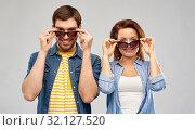 Купить «happy couple in sunglasses over grey background», фото № 32127520, снято 17 марта 2019 г. (c) Syda Productions / Фотобанк Лори