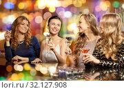 Купить «happy women drinks in glasses at night club», фото № 32127908, снято 21 ноября 2015 г. (c) Syda Productions / Фотобанк Лори