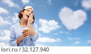 Купить «woman in pajama and eye mask with coffee yawning», фото № 32127940, снято 6 марта 2019 г. (c) Syda Productions / Фотобанк Лори