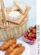 Купить «picnic basket, food and wine glasses on blanket», фото № 32128004, снято 9 августа 2017 г. (c) Syda Productions / Фотобанк Лори