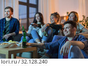 Купить «happy friends with drinks watching tv at home», фото № 32128240, снято 22 декабря 2018 г. (c) Syda Productions / Фотобанк Лори