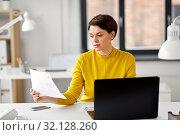 Купить «creative woman working on user interface at office», фото № 32128260, снято 23 февраля 2019 г. (c) Syda Productions / Фотобанк Лори