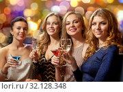 happy women drinks in glasses at night club. Стоковое фото, фотограф Syda Productions / Фотобанк Лори