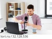 Купить «male audio blogger connecting cable to microphone», фото № 32128536, снято 24 апреля 2019 г. (c) Syda Productions / Фотобанк Лори