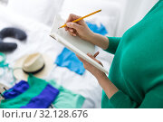 Купить «woman going on trip and making list in notebook», фото № 32128676, снято 18 января 2017 г. (c) Syda Productions / Фотобанк Лори