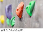 Купить «close up of rock holder on indoor climbing wall», фото № 32128684, снято 2 марта 2017 г. (c) Syda Productions / Фотобанк Лори