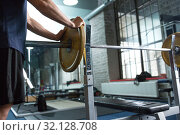 Купить «close up of man with barbell weight in gym», фото № 32128708, снято 2 июля 2017 г. (c) Syda Productions / Фотобанк Лори