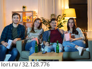 Купить «friends with beer and popcorn watching tv at home», фото № 32128776, снято 22 декабря 2018 г. (c) Syda Productions / Фотобанк Лори