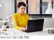 Купить «happy businesswoman with laptop working at office», фото № 32128780, снято 23 февраля 2019 г. (c) Syda Productions / Фотобанк Лори