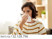 Купить «sick woman blowing nose in paper tissue at home», фото № 32128796, снято 6 марта 2019 г. (c) Syda Productions / Фотобанк Лори