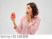 shocked young woman in pajama with alarm clock. Стоковое фото, фотограф Syda Productions / Фотобанк Лори