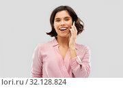 Купить «young woman in striped shirt calling on smartphone», фото № 32128824, снято 6 марта 2019 г. (c) Syda Productions / Фотобанк Лори