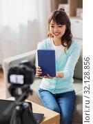 Купить «asian female blogger making video review of book», фото № 32128856, снято 13 апреля 2019 г. (c) Syda Productions / Фотобанк Лори