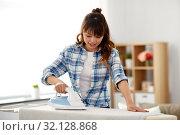Купить «asian woman ironing bed linen at home», фото № 32128868, снято 13 апреля 2019 г. (c) Syda Productions / Фотобанк Лори