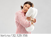 happy young woman in pajama hugging pillow. Стоковое фото, фотограф Syda Productions / Фотобанк Лори