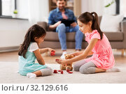 Купить «girls playing with toy crockery and teddy at home», фото № 32129616, снято 31 марта 2019 г. (c) Syda Productions / Фотобанк Лори