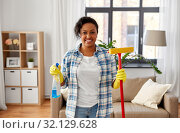Купить «african woman with window detergent and sponge mop», фото № 32129628, снято 7 апреля 2019 г. (c) Syda Productions / Фотобанк Лори