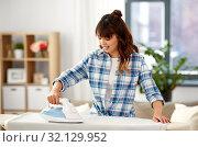 Купить «asian woman ironing bed linen at home», фото № 32129952, снято 13 апреля 2019 г. (c) Syda Productions / Фотобанк Лори