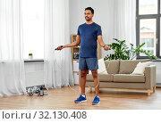 Купить «indian man exercising with jump rope at home», фото № 32130408, снято 19 мая 2019 г. (c) Syda Productions / Фотобанк Лори