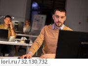 Купить «man with computer working late at night office», фото № 32130732, снято 26 ноября 2017 г. (c) Syda Productions / Фотобанк Лори