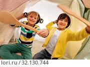 Купить «boys with pots playing in kids tent at home», фото № 32130744, снято 18 февраля 2018 г. (c) Syda Productions / Фотобанк Лори