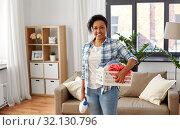 Купить «woman with basket and laundry detergent at home», фото № 32130796, снято 7 апреля 2019 г. (c) Syda Productions / Фотобанк Лори