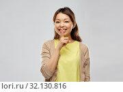 Купить «happy asian woman with finger on lips», фото № 32130816, снято 11 мая 2019 г. (c) Syda Productions / Фотобанк Лори