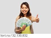 Купить «asian woman with euro money showing thumbs up», фото № 32130832, снято 11 мая 2019 г. (c) Syda Productions / Фотобанк Лори