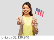 happy asian woman with american flag. Стоковое фото, фотограф Syda Productions / Фотобанк Лори