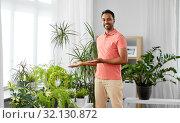 Купить «indian man taking care of houseplants at home», фото № 32130872, снято 19 мая 2019 г. (c) Syda Productions / Фотобанк Лори