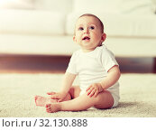 Купить «happy baby boy or girl sitting on floor at home», фото № 32130888, снято 12 июля 2016 г. (c) Syda Productions / Фотобанк Лори