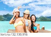 Купить «young women in bikini with ice cream on beach», фото № 32130916, снято 11 июля 2013 г. (c) Syda Productions / Фотобанк Лори