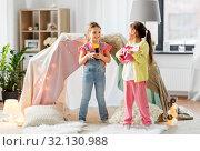 Купить «girls with guitar and microphone playing at home», фото № 32130988, снято 18 февраля 2018 г. (c) Syda Productions / Фотобанк Лори