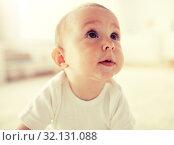 Купить «close up of happy little baby boy or girl at home», фото № 32131088, снято 12 июля 2016 г. (c) Syda Productions / Фотобанк Лори