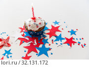 Купить «cupcake with candle and stars at 4th july party», фото № 32131172, снято 28 мая 2015 г. (c) Syda Productions / Фотобанк Лори