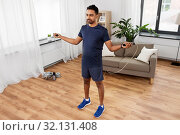 Купить «indian man exercising with jump rope at home», фото № 32131408, снято 19 мая 2019 г. (c) Syda Productions / Фотобанк Лори