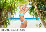 Купить «young woman posing in bikini on beach», фото № 32131516, снято 20 апреля 2017 г. (c) Syda Productions / Фотобанк Лори