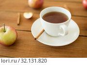 Купить «cup of tea with apples and cinnamon on table», фото № 32131820, снято 24 августа 2018 г. (c) Syda Productions / Фотобанк Лори