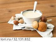 Купить «mushroom cream soup in bowl on cutting board», фото № 32131832, снято 13 сентября 2018 г. (c) Syda Productions / Фотобанк Лори