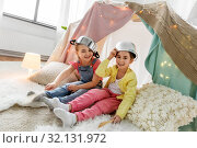 Купить «girls with pots playing in kids tent at home», фото № 32131972, снято 18 февраля 2018 г. (c) Syda Productions / Фотобанк Лори