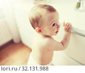 Купить «close up of happy little baby boy or girl at home», фото № 32131988, снято 12 июля 2016 г. (c) Syda Productions / Фотобанк Лори