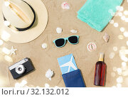travel tickets, camera and hat on beach sand. Стоковое фото, фотограф Syda Productions / Фотобанк Лори