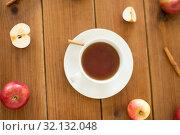 Купить «cup of tea with apples and cinnamon on table», фото № 32132048, снято 24 августа 2018 г. (c) Syda Productions / Фотобанк Лори